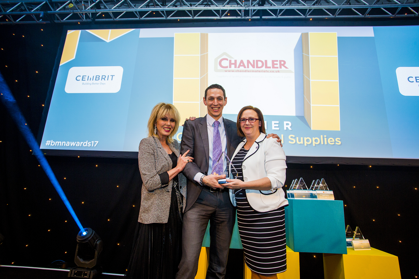 Winner of Website & Digital Initiative of the Year; Joanna Lumley, Ben Chandler, Finance Director - Chandler Material Supplies Ltd,  Samantha Hanks, National Key Account & Specification Manager - Cembrit