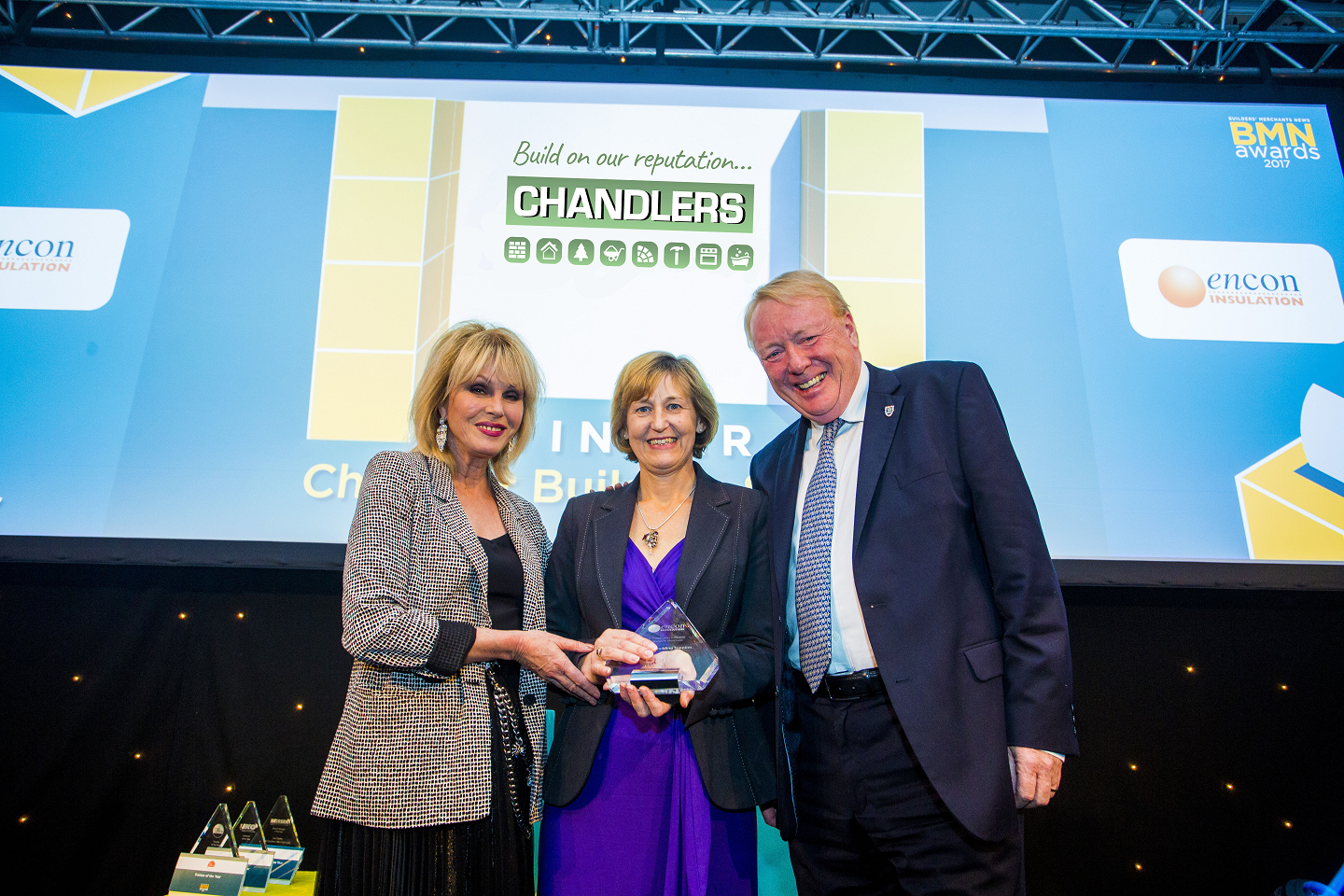 Winner of Best Community Initiative by a Builders' Merchant; Joanna Lumley, Sue McKinney, Marketing Manager - Chandlers Building Supplies Ltd ,  Mike Beard, Merchant Development Director - Encon Insulation