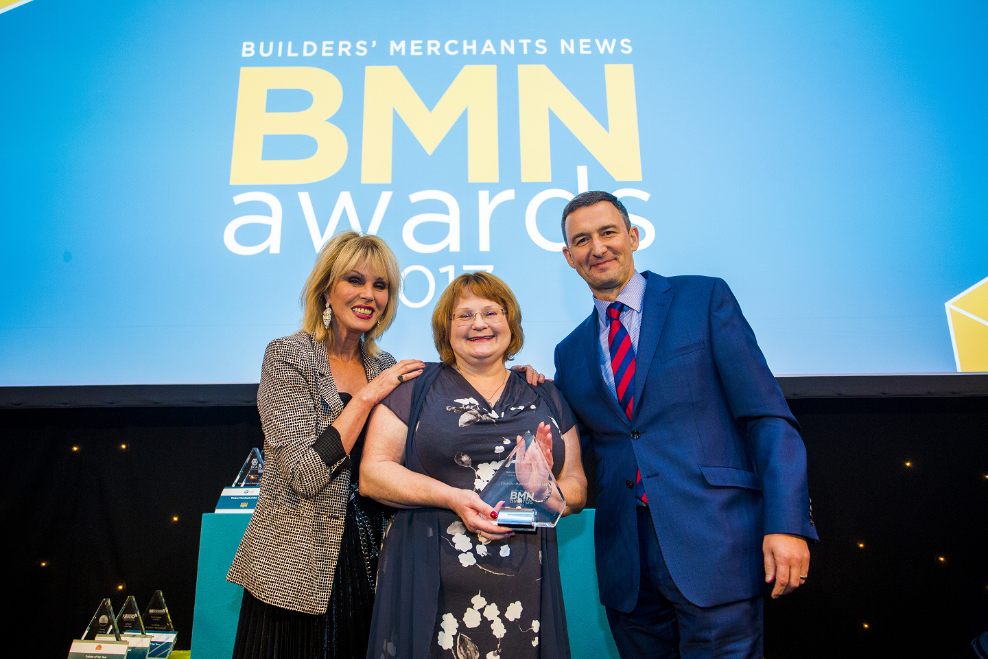 Winner of Independent Builders' Merchant of the Year (1 - 10); Joanna Lumley, Julie Chandler, Managing Director - Chandler Material Supplies Ltd, Adrian Forbes, Group Sales Director - Keystone Group
