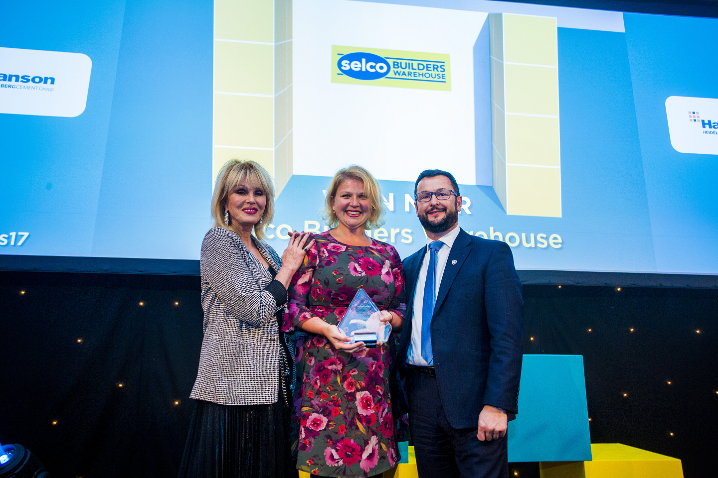 Winner of National Builders' Merchant of the Year; Joanna Lumley, Carine Jessamine, Marketing Director - Selco Builders Warehouse,  Andrew Simpson, National Commercial Director - Packed - Hanson Cement