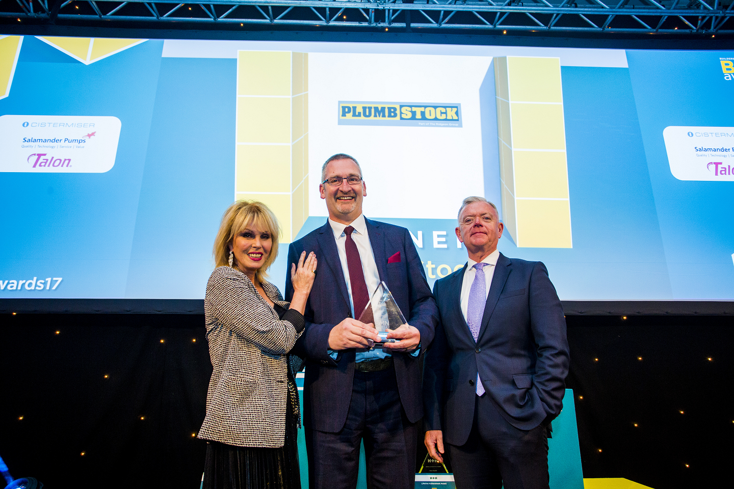 Winner of Heating & Plumbing Merchant of the Year; Joanna Lumley, Hugh Guntrip, Director of Plumbstock,  Danny Hughes, Managing Director - Salamander Pumps